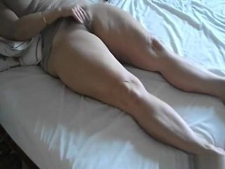 Mature doll fondles her furry vagina in the morning