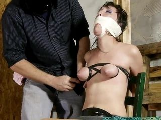 A salvegirl gauze mummified and tormented with plastic bag by her sir