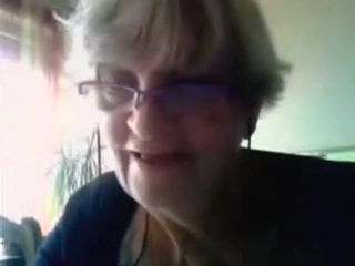 Granny has cybersex with a stranger on cam and flashes her big boobs