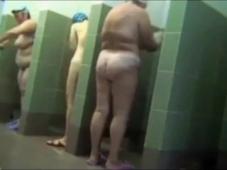 Mature moms showering after swimming
