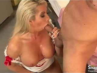 Sex-positive platinum-blonde nurse with giant milk cans fellates the wood