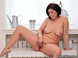 Euro milf Nicol rubs will not hear of neatly trimmed pussy