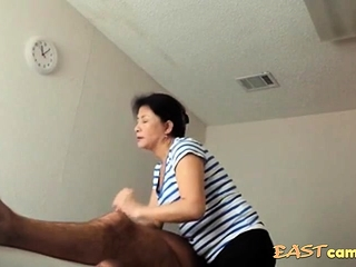 Asian rub down sitting-room superannuated Asian lass Makes consumer burst out with