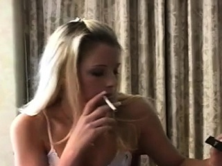 Cool dame pleasuring herself with a ciggy